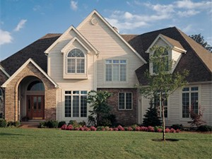 There are many more siding choices today than brick and wood siding seen on this home