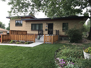 Fencing is seen along side yard and enclosing front stoop and patio.
